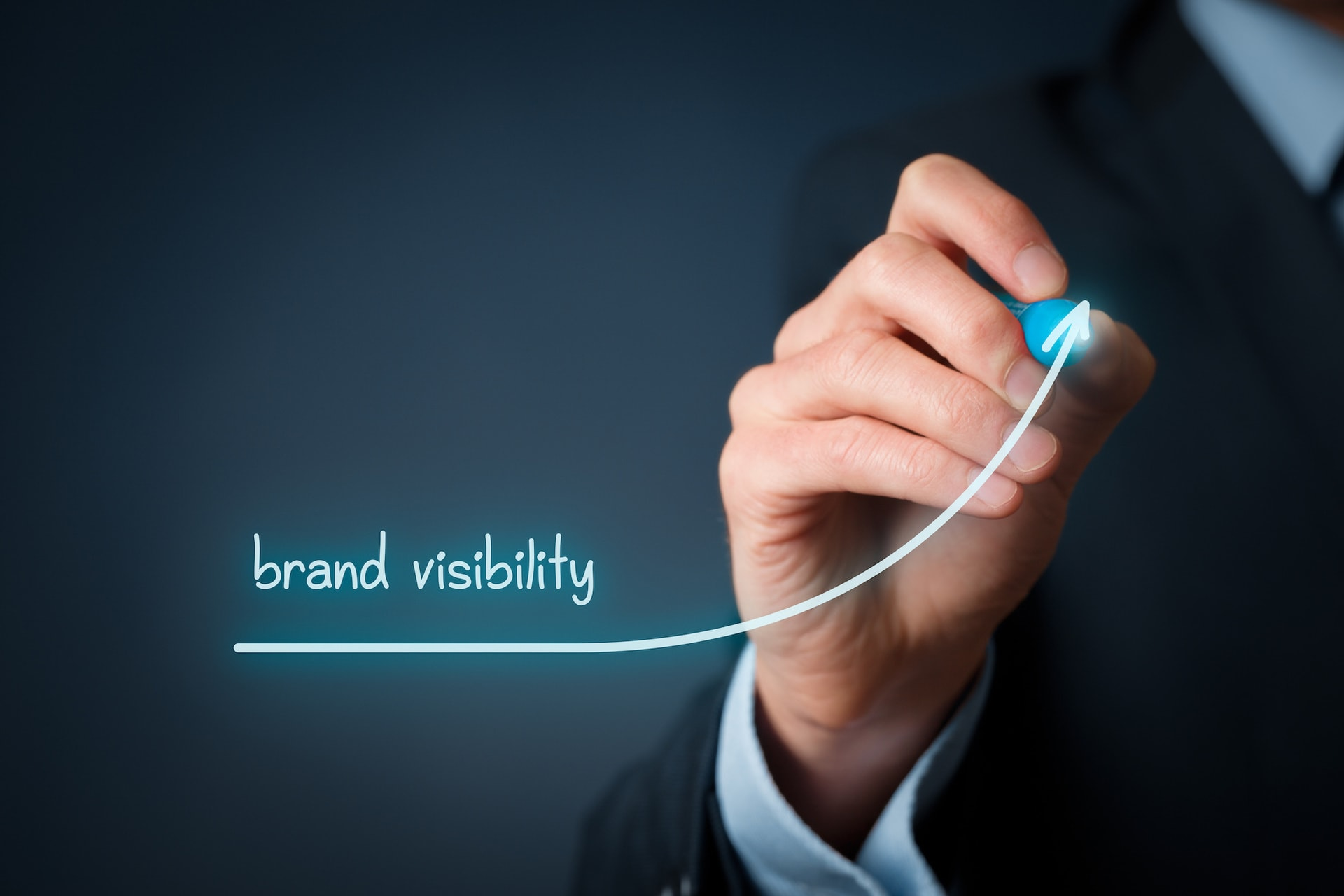 Brand visibility improvement concept. Brand manager (marketing specialist) draw growing graph with text brand awareness.
